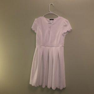 White mid length dress